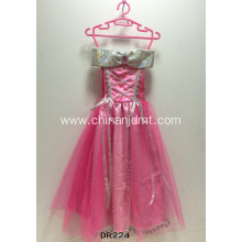 Pink ankle-length dress with ribbons.